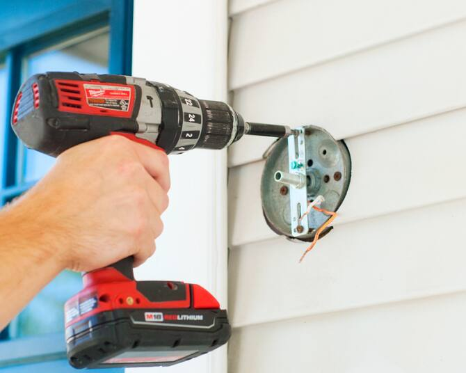 Securing Exterior Light Mounting Bracket With Drill